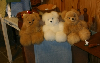 a variety of products made from alpaca fiber